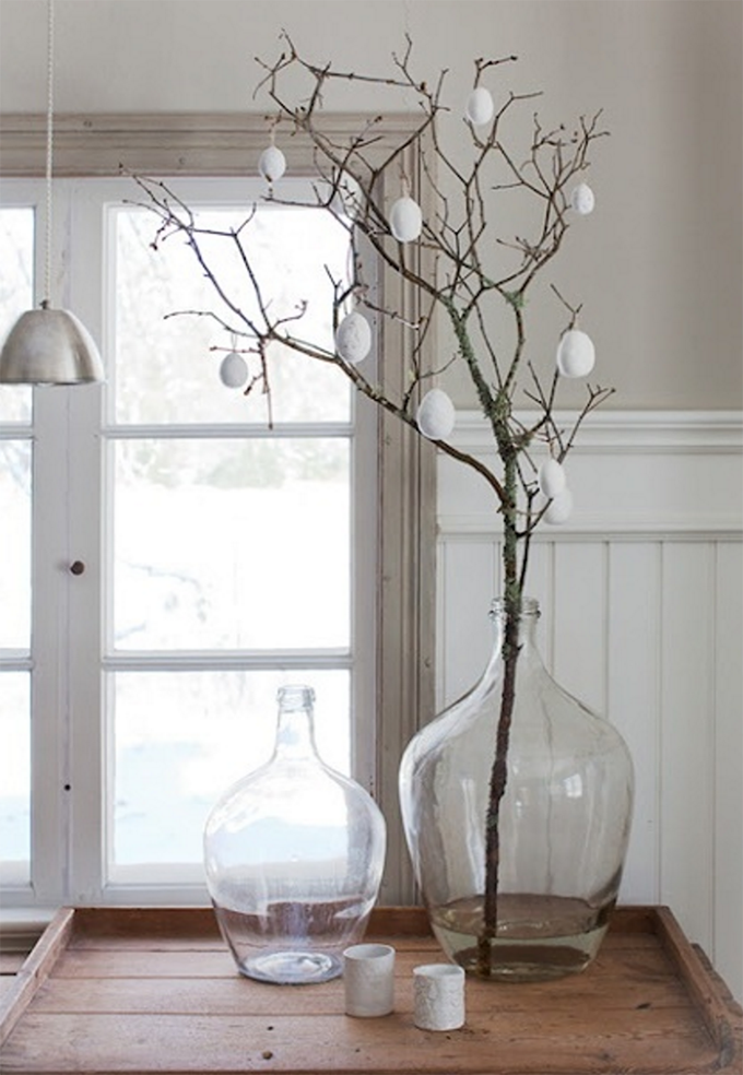 White eggs on a branch in big vase
